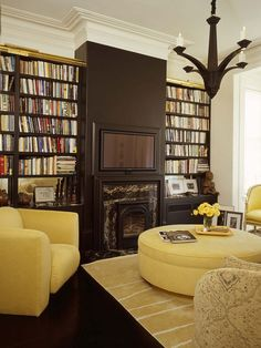 Very cozy library/TV room where the TV takes a visual back seat - 50 Jaw-dropping home library design ideas