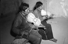 Tarahumara men from Mexico's Sierra Madre playing home-made violins (more on the viola side perhaps?)