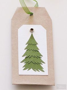 A pretty layered tree adds sweetness to a basic tag shape. Use a punch or hand-cut a Christmas tree shape from five scraps of green paper. Layer the scraps together and attach to a white tag mounted on a kraft paper tag.