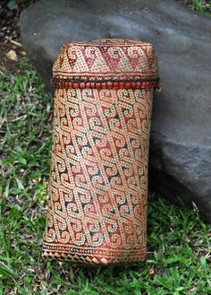 lidded basket with traditional motif and colours made by Dayak people from West Kalimantan