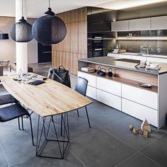 White, wood and grey are a perfect classic colour combination in the kitchen. The handless cupboard create a sleek seamless look through the whole kitchen. http://www.housetohome.co.uk/kitchen/articles/9-german-kitchens-that-will-make-you-love-sleek_532742.html