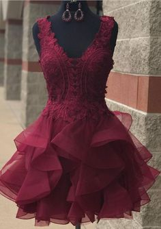 Lace home in a dark purple homecoming gown
