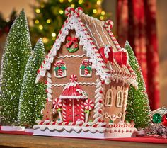 This gingerbread house will last year after year and illuminates!  H206403 (choice of three styles). http://qvc.co/-Shop-ValerieParrHill