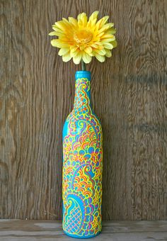 Hand Painted Wine bottle Vase, Turquoise bottle with sunshine yellow, orange and pink accents,