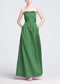 The A-line skirt on this satin strapless gown creates a clean and simple silhouette that, combined with a wide ruched waist band, is flattering to various shapes and sizes. Side skirt pockets and a slight sweetheart neckline are playful and feminine updates. Every maid is sure to make a dramatic entrance in this show stopping gown. Also available in extra length sizes. Get inspired by our colors. This neckline is shaped like the top of a heart and is flattering to the decolletage.A popular…