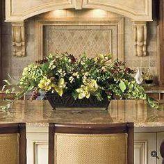Backsplash | light granite with the ivory cabinets