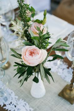 garden rose centerpiece in milk glass, photo by John Newsome http://ruffledblog.com/romantic-la-jolla-beach-wedding #centerpieces #flowers