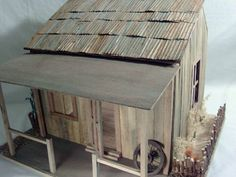 DIY rusty tin roof (or metal stored in shed) using aluminum foil, a fabric pleater or similar and grey, orange and brown paint - Source: Greenleaf Gazette