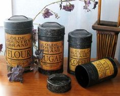4pc Olde Country Brands METAL CANISTER SET Black & Yellow FLOUR SUGAR COFFEE TEA Country Kitchen Farmhouse, Primitive Kitchen, Farmhouse Decor, Country Kitchens, Sugar Canister, Canister Sets, Tin Can Alley, Kitchen Canisters, Black N Yellow