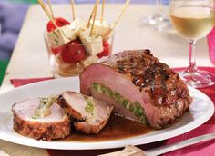 Swiss-stuffed grilled pork roast. Made with asparagus and swiss. Have to try this.