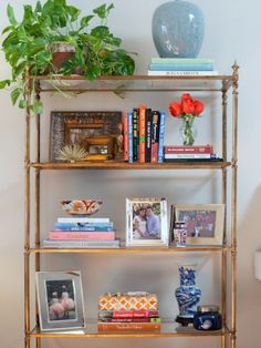 Group your favorite books and knick-knacks together, but avoid overfilling your shelf to create a light and airy display.
