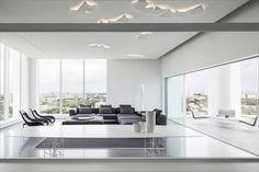 The elegant white penthouse in Tel Aviv, Israel was built by the project of the design studio Pitsou Kedem Architects. Contemporary Interior Design, Modern Interior, Interior Architecture, Monochromatic Living Room, Pitsou Kedem, Corridor Design, Appartement Design, Floor To Ceiling Windows, Light Design