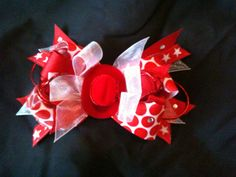 Red rodeo bow with hat center