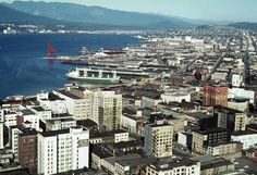 https://flic.kr/p/L3C9Mf | August 1972 | Downtown is dominated by buildings of a previous era, many of them soon to be introduced to the wrecking ball.  Higher buildings have replaced many in the past 44 years as both downtown and the waterfront are re-invented, scarce waterfront land at a premium for the harbour facilities that must maximize efficiency for Canada's Pacific gateway for overseas trade.