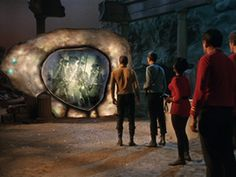 The Enterprise crew encounters the Guardian of Forever in The City on the Edge of Forever--This episode involves the crew of the starship USS Enterprise discovering a portal through space and time, which leads to Dr. McCoy's accidentally altering history.