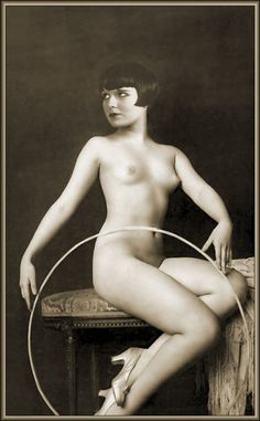 (Ziegfeld Girl) This lovely poses with a hoop and heels. Her darling bob hair cut goes perfect with her sultry eyes.