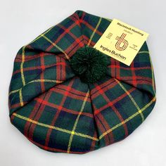 Keep warm and look ultra stylish in this light-weight, worsted wool unisex tartan tam. This...