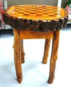 Natural log chess table with chess pieces and checkers..