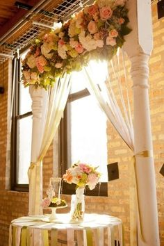 ceremony backdrops- pretty... the curtains with flowers accross the top