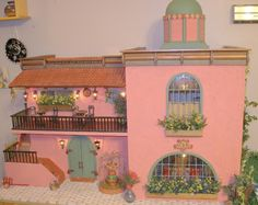 http://rhondaguy.com/dollhouses-miniatures/dollhouses/112-scale-dollhouses/casa-maria/