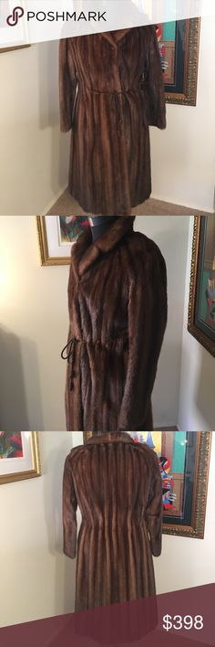 ⭐️REAL MINK LONG COAT 💯AUTHENTIC LONG MINK COAT 💯AUTHENTIC. SO BEAUTIFUL PURCHASED BY MY MOTHER IN 1990 AT THE HUTZLERS FUR SALON. THE COLOR IS BROWN & WAS KEPT YEARLY IN COLD STORAGE. THE FUR IS STABLE. TINY WEAR OVERALL BEAUTIFUL.  HAS BOTH CLOSURE HOOKS & WAIST BELT. BELT CAN BE REMOVED IF YOU WISH. LINING IS STUNNING. THE BUST IS 20 INCHES ACROSS & 40 AROUND WHEN CLOSED. THE LENGTH IS SLEEVE IS  23 INCHES FROM TOP TO BOTTOM. COAT LENGTH IS 43 INCHES. HIP IS 23 INCHES ACROSS AND 46…