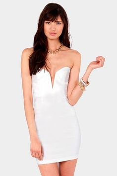 Check it out from Lulus.com! You can have it all, in the Rolling in the Deep V White Strapless Dress! A strapless, bustier bodice in a stretchy woven material forms a lightly cupped bust, in a sweetheart cut that dips into an extra deep V in the center, with hidden boning to keep its shape. The body-con glamour continues into a curve-hugging, darted tube skirt. Hidden back zipper. Cups are lined. Model is wearing a size small. 74% Rayon, 22% Nylon, 4% Spandex. Hand Wash Cold. Made with Love…