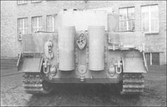 Pz.Kpfw.Tiger Ausf.E completed by Henschel in late Feb/early March 1944 .Narrow transport tracks ,steel-tired roadwheels,smaller diameter idlers,and a turret ring guard ,but no longer has a rear travel lock.