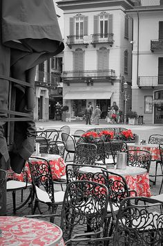 Cafe On The Square. Photography by Andrea Rea. A stylish cafe on Piazza Garibaldi in Menaggio, Italy. In the Lombardy region of northern Italy, old town Menaggio is a popular destination on Lake Como best known for its Renaissance architecture and distinct 19th century buildings in Italian alpine style. Black and white rendition with selective coloring. Original work available as framed print, canvas and more only on Fine Art America and Pixels.com. https://andrea-rea.pixels.com/