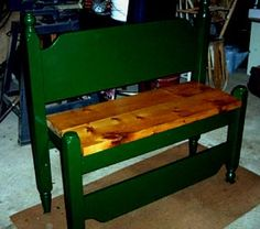 Bench made from the head board and foot board of a bunk bed.