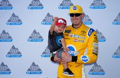 DOVER, DE - JUNE 02: Kyle Busch, driver of the #18 Pedigree Petcare Toyota, and his son Brexton pose with the Coors Light Pole Award after qualifying in the pole position for the Monster Energy NASCAR Cup Series AAA 400 Drive for Autism at Dover International Speedway on June 2, 2017 in Dover, Delaware. (Photo by Chris Trotman/Getty Images)
