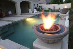 """Fire pits, fire bowls, and fireplaces enhance any outdoor living area; here are some of the best creative """"warm spots"""" we've seen in 2013!"""