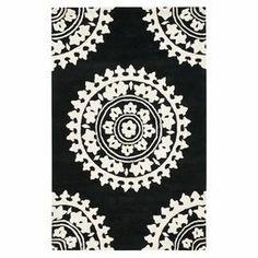 "Add a pop of pattern to your living room or den with this hand-tufted wool rug, showcasing a medallion motif in black and ivory.  Product: RugConstruction Material: New Zealand woolColor: Black and ivoryFeatures: Hand-tuftedPile Height: 0.625"" Note: Please be aware that actual colors may vary from those shown on your screen. Accent rugs may also not show the entire pattern that the corresponding area rugs have.Cleaning and Care: Professional cleaning recommended"
