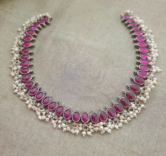 Silver , simple kempu adigai with spinel stones. Indian Jewelry Sets, Silver Jewellery Indian, Bridal Jewelry Sets, Silver Jewelry, Antique Jewellery Designs, Gold Earrings Designs, Necklace Designs, Terracota Jewellery, Simple Jewelry