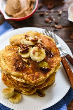 These Banana Pancakes are studded with caramelized bananas and topped with syrup and toasted pecans.