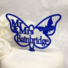 Blue Butterfly Wedding Cake topper, personalised Mr & Mrs or Same Sex (Mr & Mr, Mrs and Mrs) with any surname and date you would like. Add that extra special finishing touch to your wedding cake with this beautiful translucent blue cake topper. Great for any blue wedding colour scheme or butterfly theme.