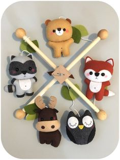 Made to order (current turnaround time is 8-10 business days). This crib mobile is a perfect decorative piece for your nursery or baby shower/new baby gift.  •INCLUDES• 1 Wooden frame 1 Fox plushie 1 Raccoon plushie 1 Bear plushie 1 Owl plushie 1 Moose plushie Small embelishments  Made with high quality eco-friendly felt. The design is originally made by me, Angeline. I hand-cut, hand-sew each item with lots of love.  Pet & smoke free home.  The wood hangers are also handcrafted with the…