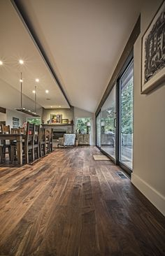 Love this colour scheme with the walnut floor and dark grey doors