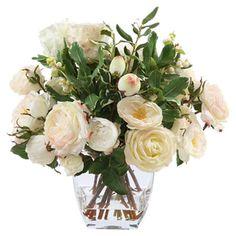 Faux rose arrangement in a glass vase.  Product: Faux floral arrangementConstruction Material: Polyester, plasti...