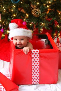 christmas present what a cute picture of a cute baby with a santa hat