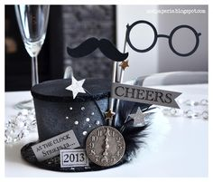 Thienly combined all the elements of NEW YEAR'S EVE SVG KIT and embellished the Top Hat from the kit!  Lots of glitter, feathers, silver and stars!  Fabulous!