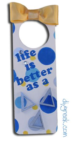 """Delta Delta Delta  TriDelt Door hanger.  DIYGreek.com carries everything you need to make this cute gift.  The Supply Sack has the paint, gems, ribbon, wood letters and glue.  The Project Pack has the Custom Polka Dot Stencil, the door hanger, and the Custom """"Life is better"""" stencil.  #sorority, #little sister, #idea"""