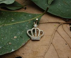 Check out this item in my Etsy shop https://www.etsy.com/listing/533176989/crown-pendantcrown-necklacegold