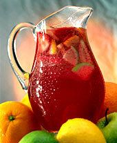 Sangria is delicious on a warm day. With a few simple ingredients you can make this drink yourself.   All you need is red wine, oranges, peaches and sugar (ofcourse you can always add your own ingredients). Use a lot of fruit and enjoy! - Marisa & Virgil