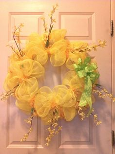 Spring! Yellow metallic deco mesh with forsythia branches and green/yellow dotted bow.