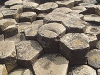 This is what columnar joints look like from the top. As it very slowly cools from magma into basalt, the rock fractures into 6-sided, pencil-like structures.