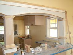 ways to open the kitchen to dining room without removing a load bearing wall ... Not this exact design but I want to do this eventually