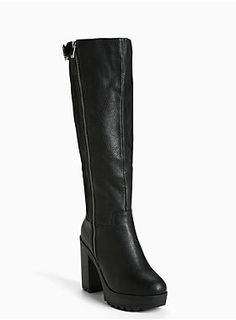 """We're twisting and shouting with these go-go inspired boots. The stacked lug heel adds some major height (and attitude) to your look. The black faux leather front edges up the look, a scuba back provides all-day comfort, totally morphing to your calves.<div><ul><li style=""""LIST-STYLE-POSITION: outside !important; LIST-STYLE-TYPE: disc !important"""">TRUE WIDE WIDTH: Designed so you never have to size up again. For the perfect fit, we recommend going down a whole size.</li><li…"""