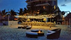 A beach reception with lounge seating feels like such an intimate occasion with your loved ones #DreamsRivieraCancun