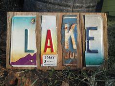 Cute shabby chic Lake sign made from scrap wood and recycled license plates. www.etsy.com/shop/artdemir