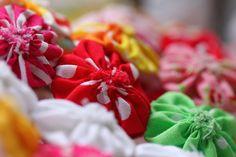 colourful suffolk puffs / yo-yos by Lilibet Stanley